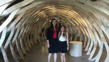 Melody Giang and Emily Huser under the main body of their installation,  The Koinobori.| Photo by Melody Giang .