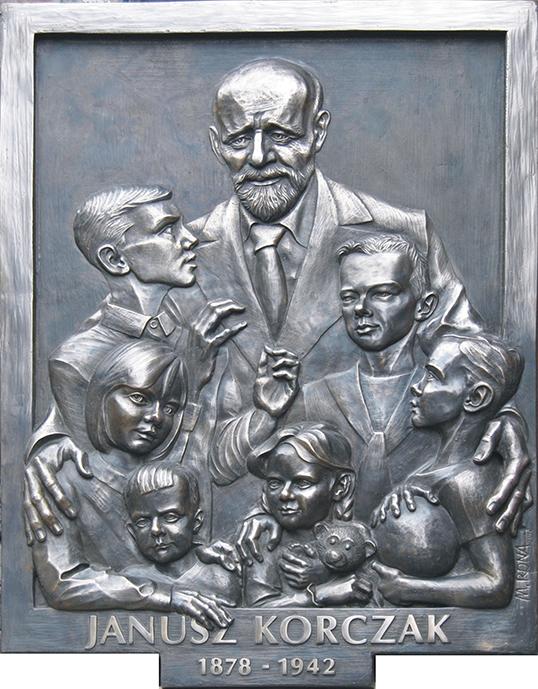 Une œuvre d'art représentant le pédiatre Janusz Korczak entouré d'enfants.