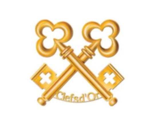 La broche dorée, symbole des Clefs d'Or. | Photo de Les Clefs d'Or
